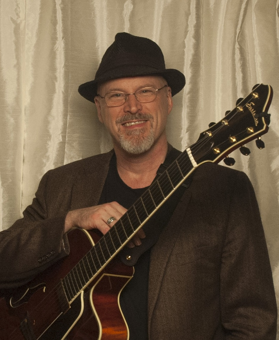 Mike Doolin with his guitar.