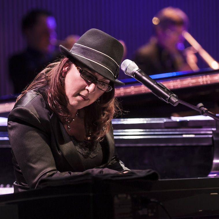 Rebeca Mauleon playing piano in live concert.